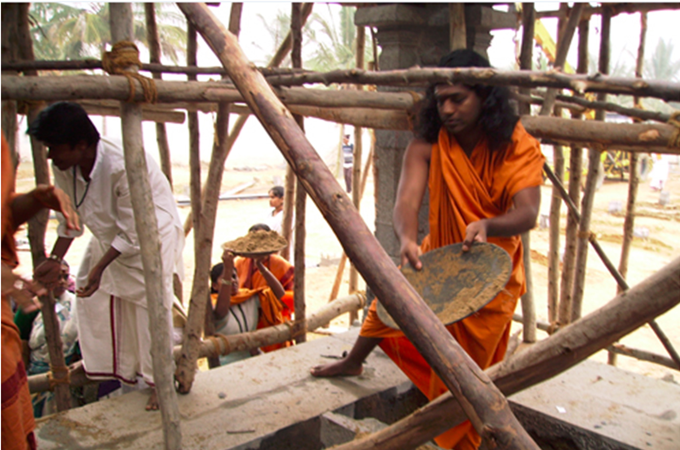 A hands-on leader, here Swamiji is helping build a temple