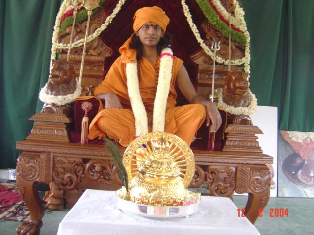 16 - Paramahamsa Sri Nithyananda during the traditional coronation ceremony along with the Kirita, (the golden crown) been offered onto him