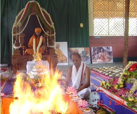 17 - Paramahamsa Sri Nithyananda presides at the fire ritual being performed as part of the traditional coronation ceremony. The Kirita, golden crown and the Svarna Pad