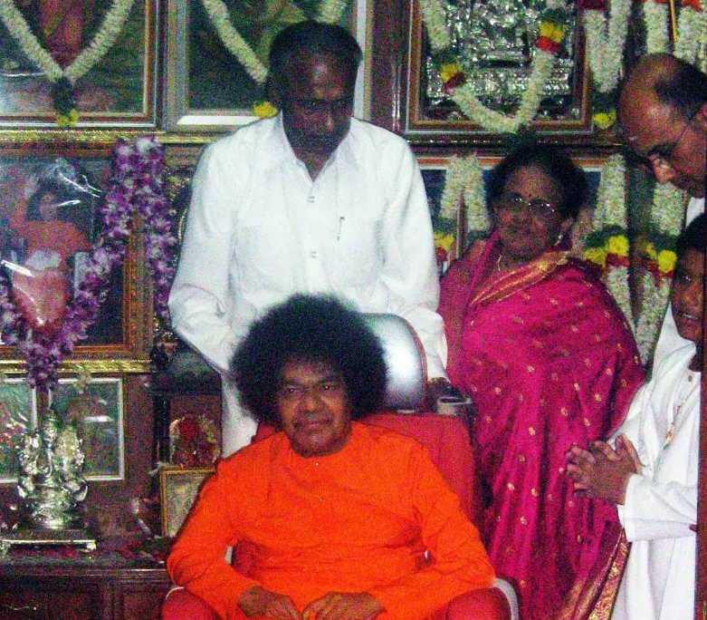 18 - The President of the Sri Sathya Sai Trust seen with Sathya Sai Baba.png